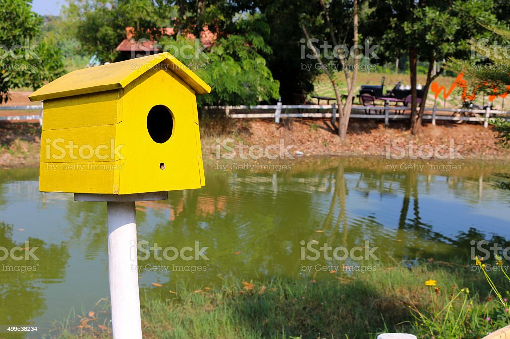 Yellow Bird house stock photo