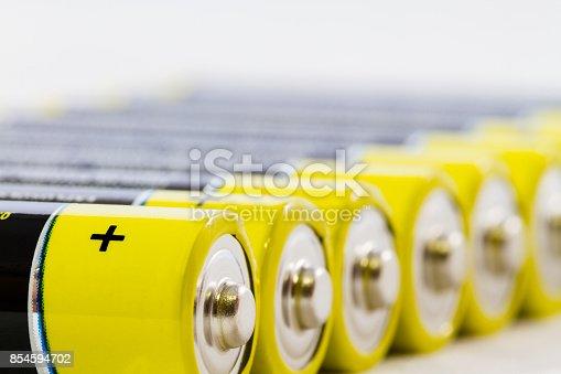 istock Yellow black AAA alkaline batteries isolated on white 854594702