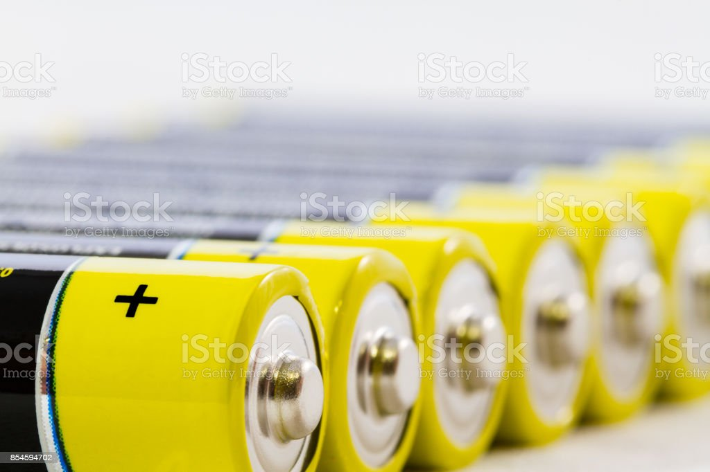 Yellow black AAA alkaline batteries isolated on white stock photo
