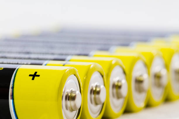 Yellow black AAA alkaline batteries isolated on white stock photo