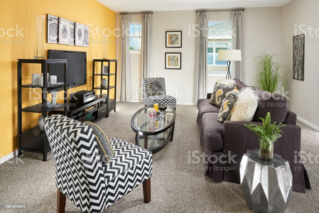 A Yellow Black And Grey Living Room With A Purple Couch In A ...