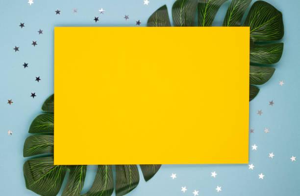 Yellow blank sheet of paper with colorful confetti on tropical leaves picture id1295571779?b=1&k=6&m=1295571779&s=612x612&w=0&h=ufjib5mqyhd2sfvlcos8o5maxv1qyo538mf7hcimlug=