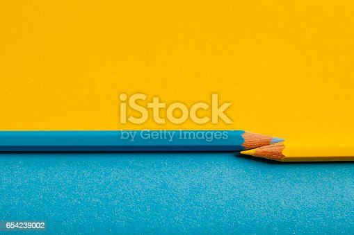 istock Yellow Blue Pencil Background 654239002