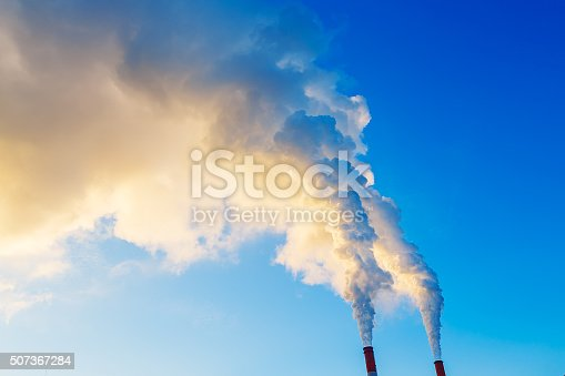 istock yellow blue smoke from two tubes of plant 507367284