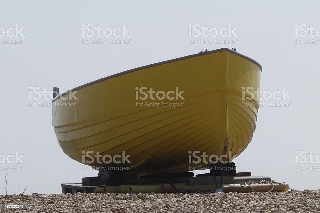 yellow boat on the beach stock photo