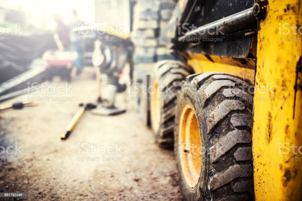 Yellow bobcat on a construction site stock photo