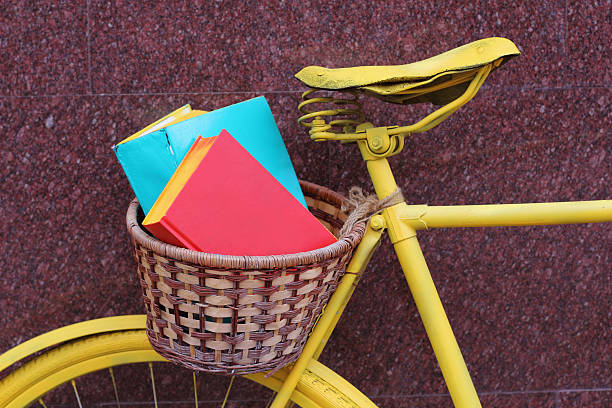 Yellow book bicycle stock photo