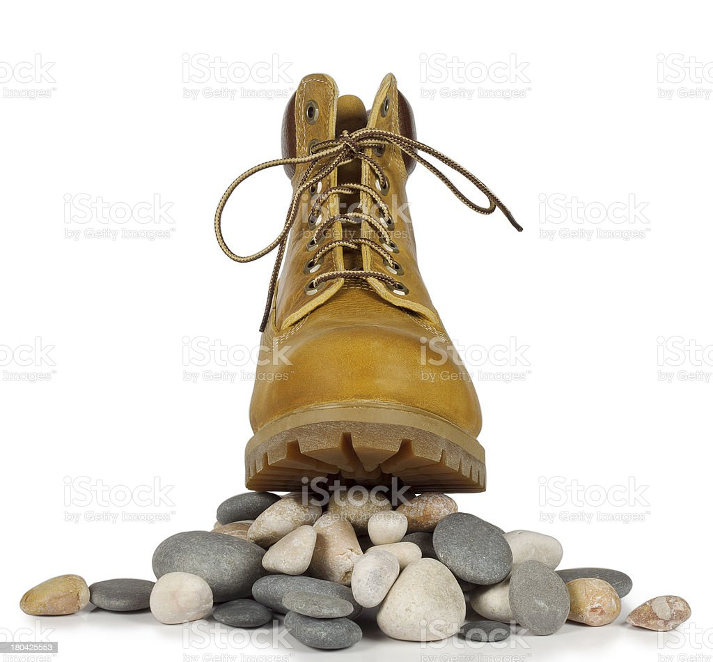 Yellow boots on the pebbles royalty-free stock photo