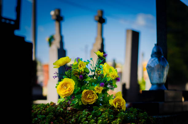 yellow bouquet of flowers in the grave in the cemetery