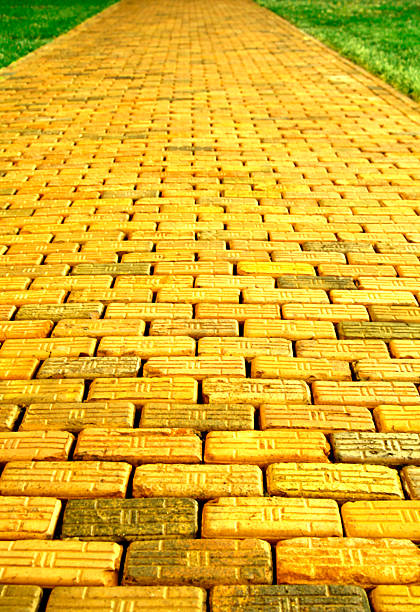 yellow brick road - yellow stock photos and pictures