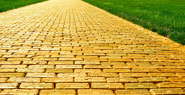 yellow brick road - wide - yellow stock photos and pictures