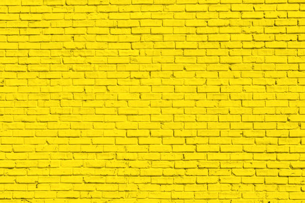 Yellow brick wall for background or texture stock photo
