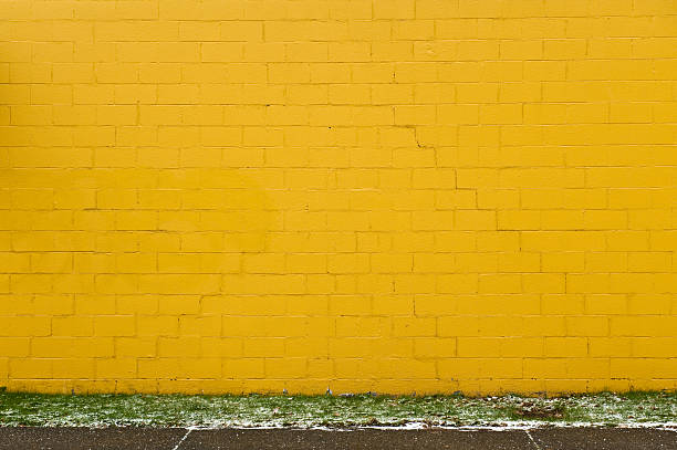yellow brick wall - yellow stock photos and pictures
