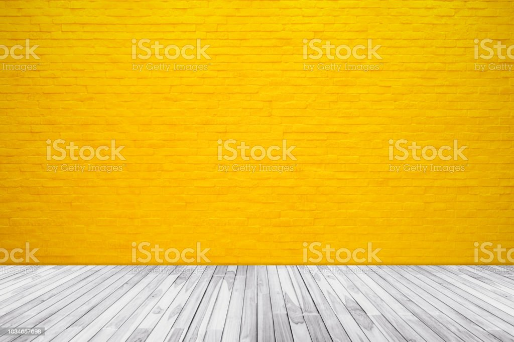 Yellow brick wall texture with wood floor background stock photo