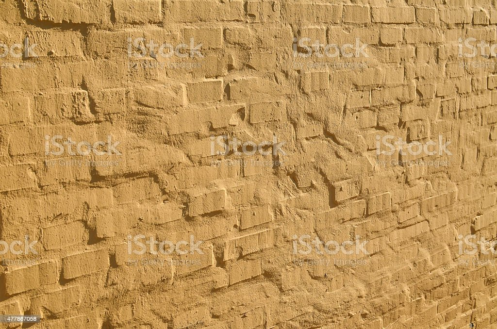 yellow bricks wall in perspective stock photo