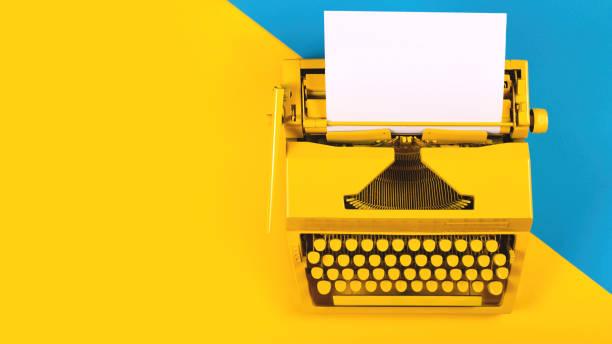 Yellow bright typewriter on a yellow background. Creativity concept Yellow bright typewriter on a yellow and blue background. Symbol for writing, blogging, new ideas and creativity. Copy space copywriter stock pictures, royalty-free photos & images