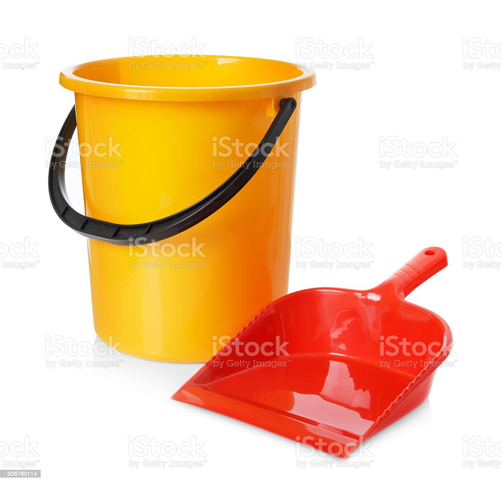 Yellow bucket and red scoop isolated on white background stock photo