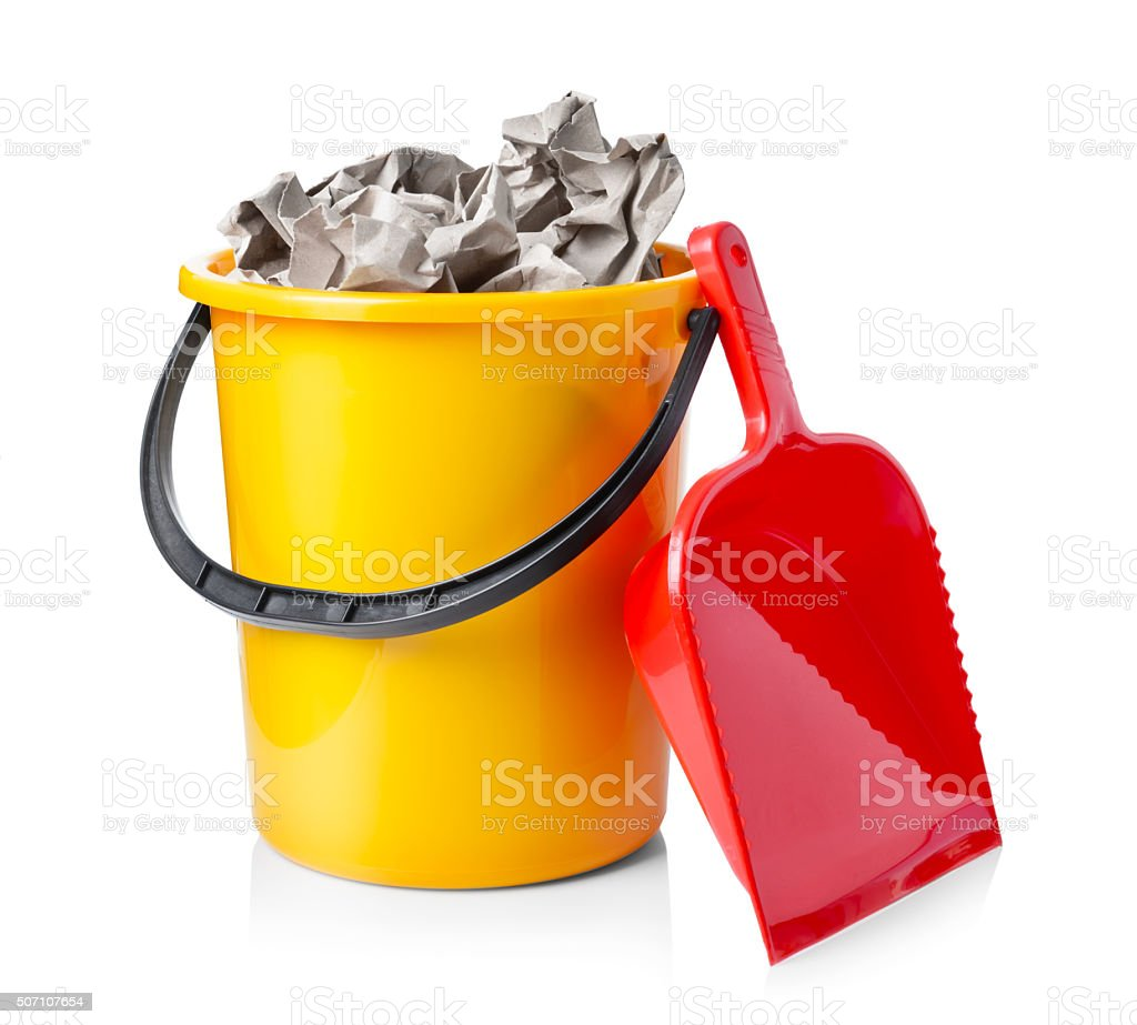 Yellow bucket with paper isolated on white backgro stock photo
