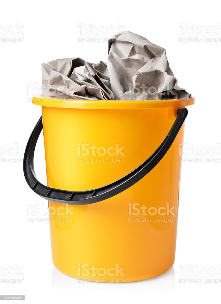 Yellow bucket with paper isolated on white background stock photo