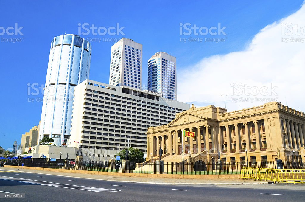 Yellow building beside skyscrapers in Colombo stock photo
