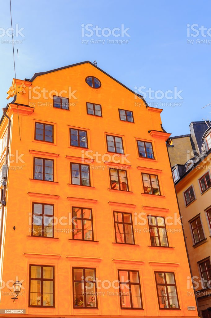 Yellow building in old town of Stockholm stock photo