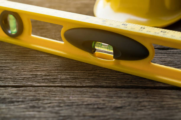Yellow building levels on old wood table - Photo