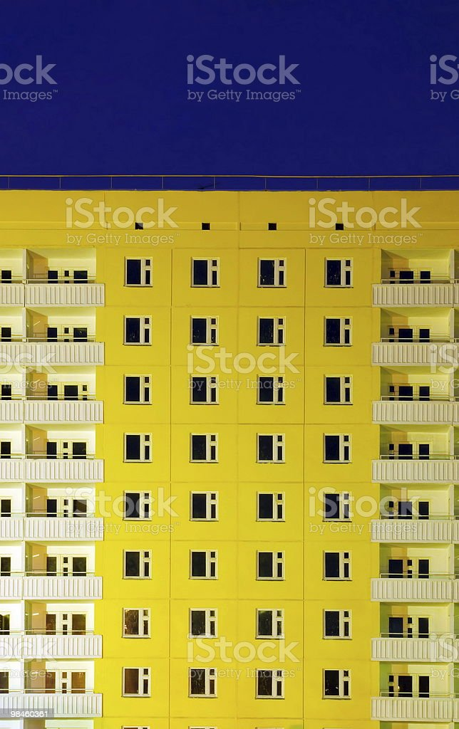 Yellow building with white balconies royalty-free stock photo