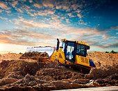istock Yellow bulldozer at a construction site 1219365623