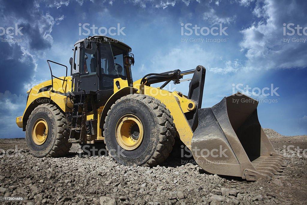 Yellow Bulldozer at Construction Site stock photo