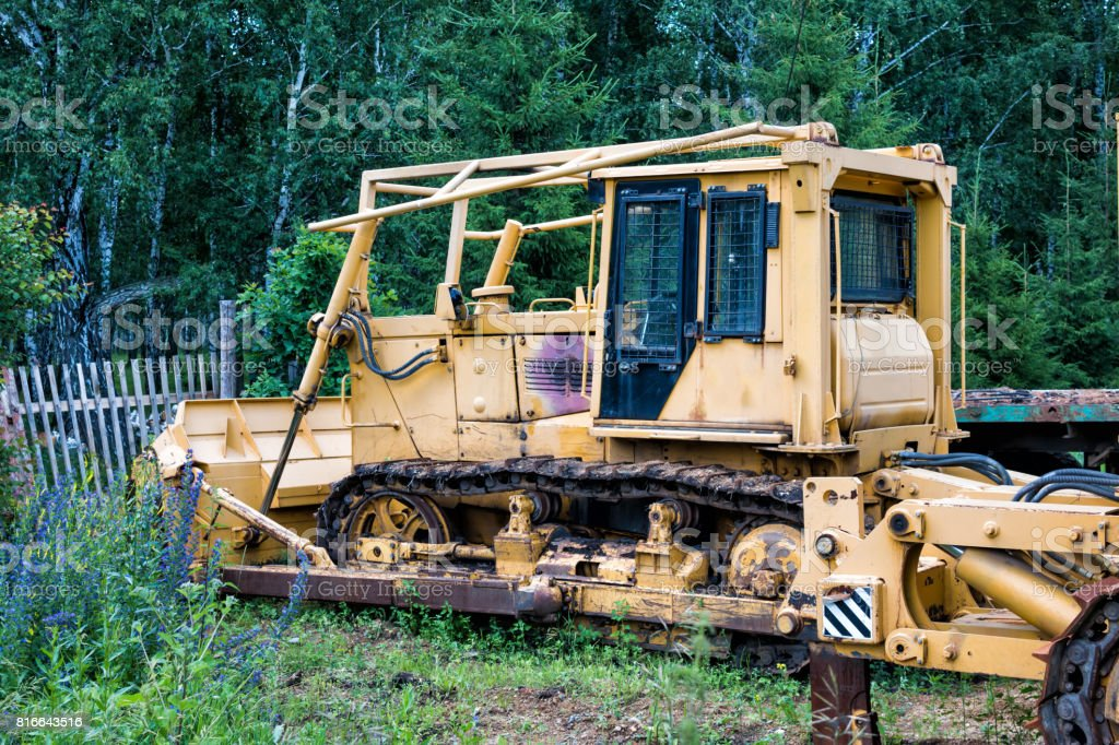 Yellow bulldozer in the forest stock photo