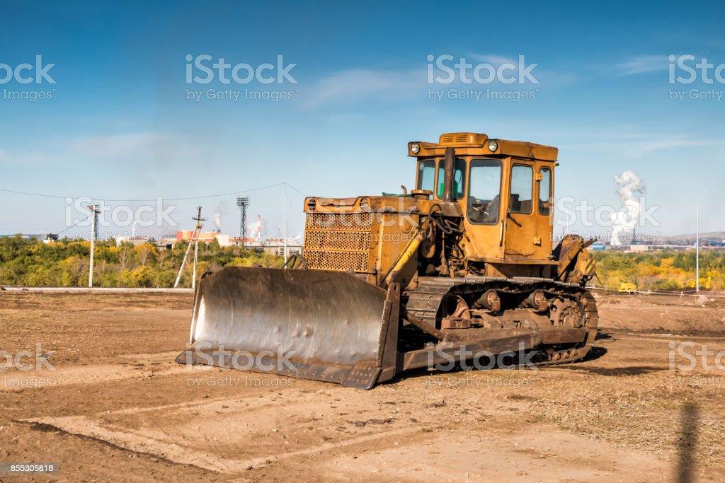 Yellow bulldozer on the construction site stock photo