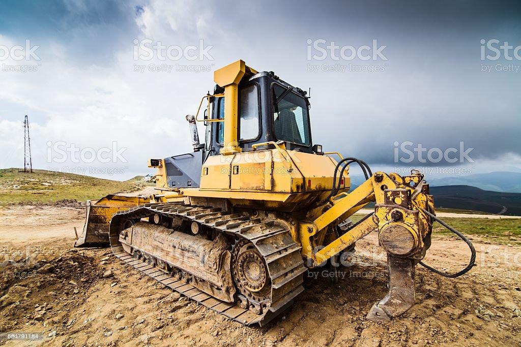 Yellow bulldozer on tracks stock photo