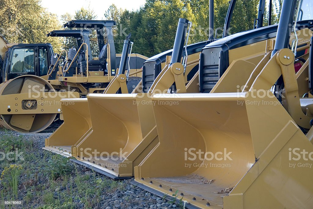 Yellow Bulldozers in a Row royalty-free stock photo