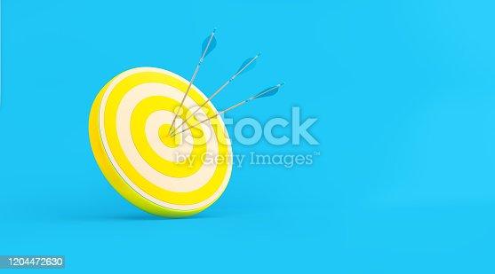 istock Yellow Bull's Eye Target over Turquoise Background 1204472630