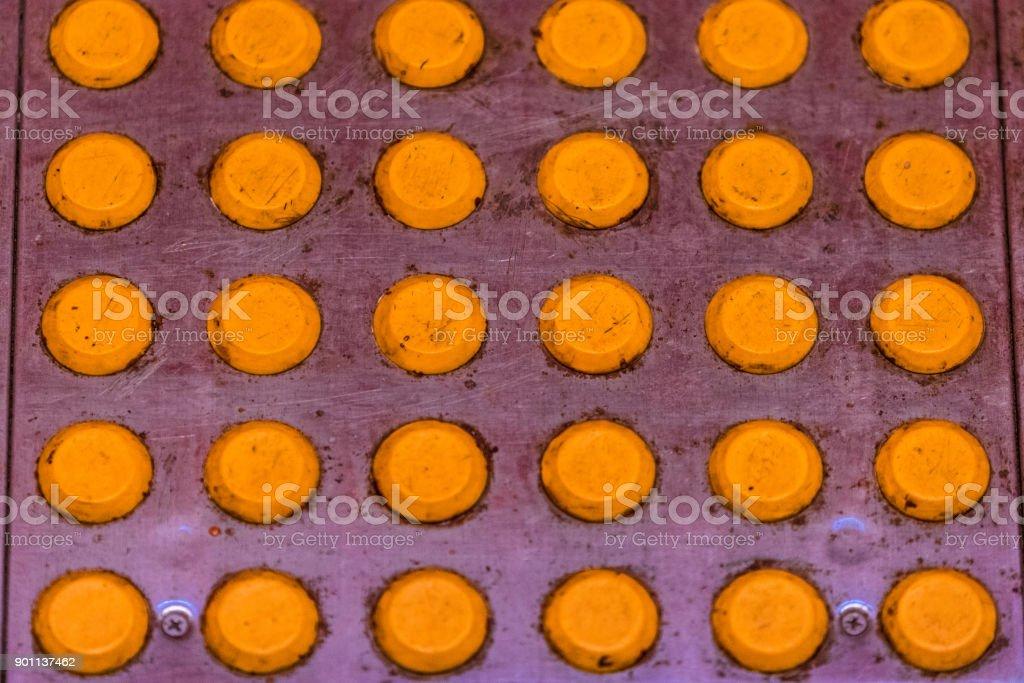Yellow bumps on the floor. stock photo