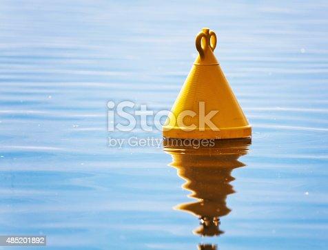 istock yellow buoy in the sea 485201892