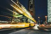 istock yellow bus on Potsdamer Platz at blue hour 1202055613