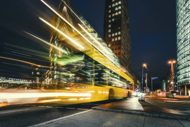 yellow bus on Potsdamer Platz at blue hour stock photo