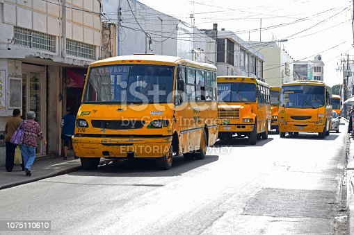 istock Yellow buses on the street in Mexico 1075110610