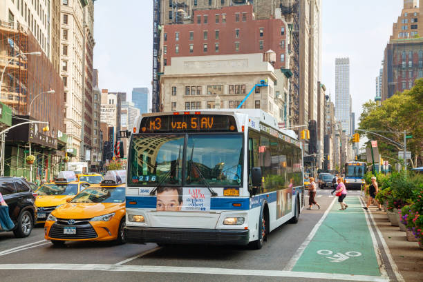 Yellow cab and bus at 5th Avenue in the morning stock photo