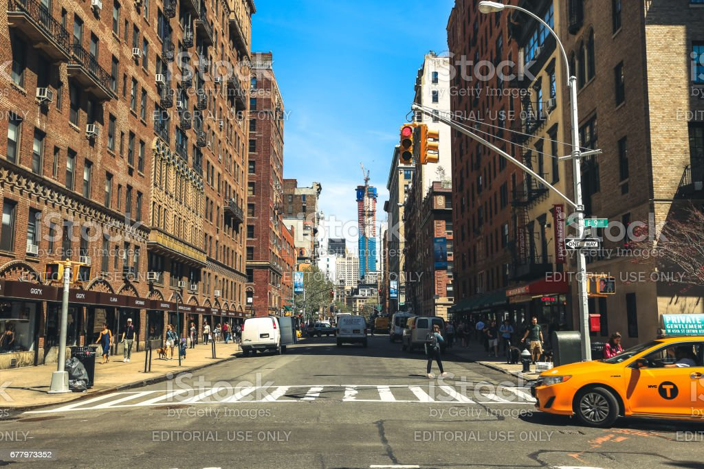 Yellow cab passing by Greenwich Village stock photo