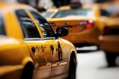 istock Yellow cab speeds through Times Square in New York, NY, USA. 693380804