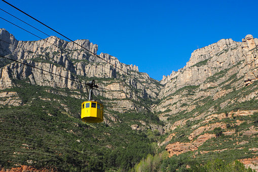 Yellow cable car at Montserrat, Spain