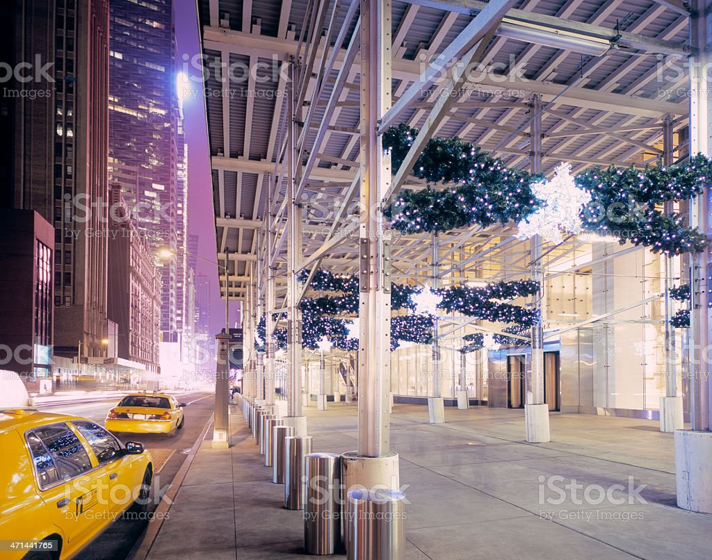 Yellow cabs and Christmas decoration in Midtown Manhattan, New York stock photo