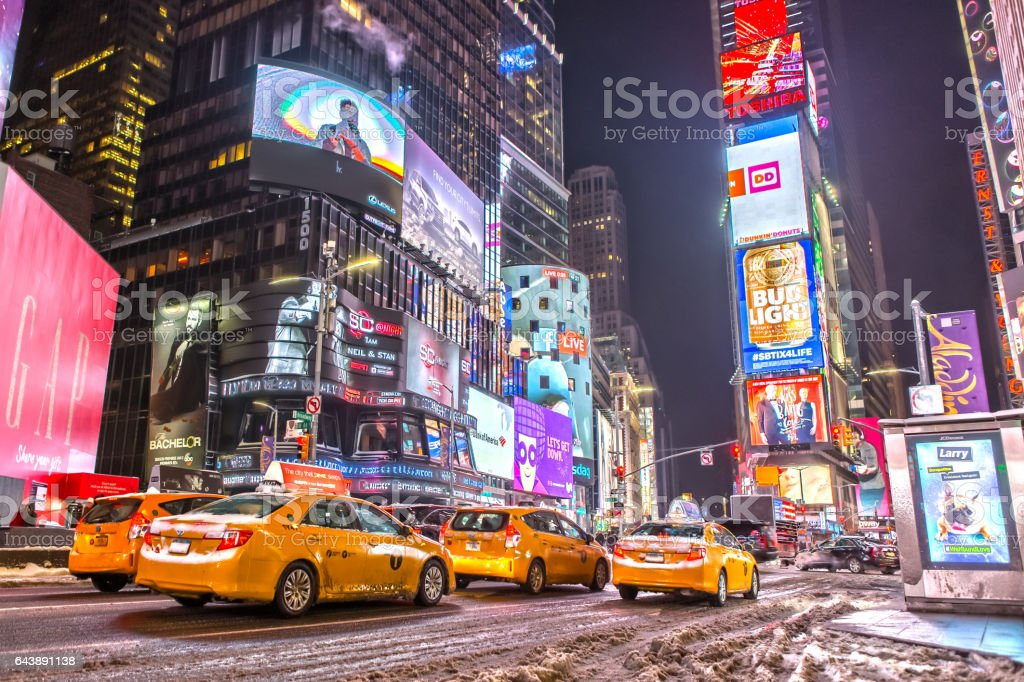 Yellow Cabs at Times Square Manhattan at Night stock photo