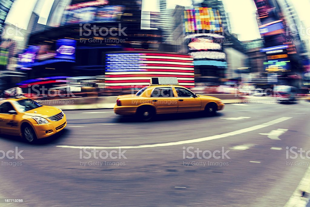 Yellow Cabs Driving in Times Square, New York City royalty-free stock photo