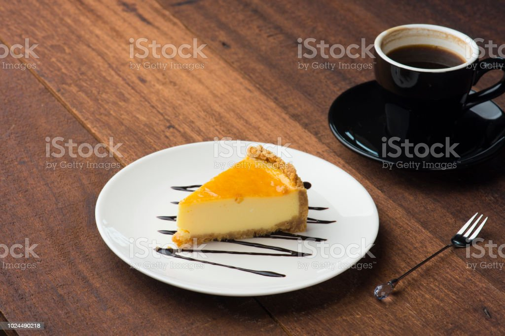 yellow cake with wood background stock photo