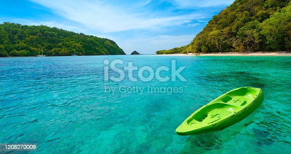 Yellow Canoe floating on the blue sea. Koh Rok island, Krabi, Thailand. Summer vacation and travel concept. Copy space