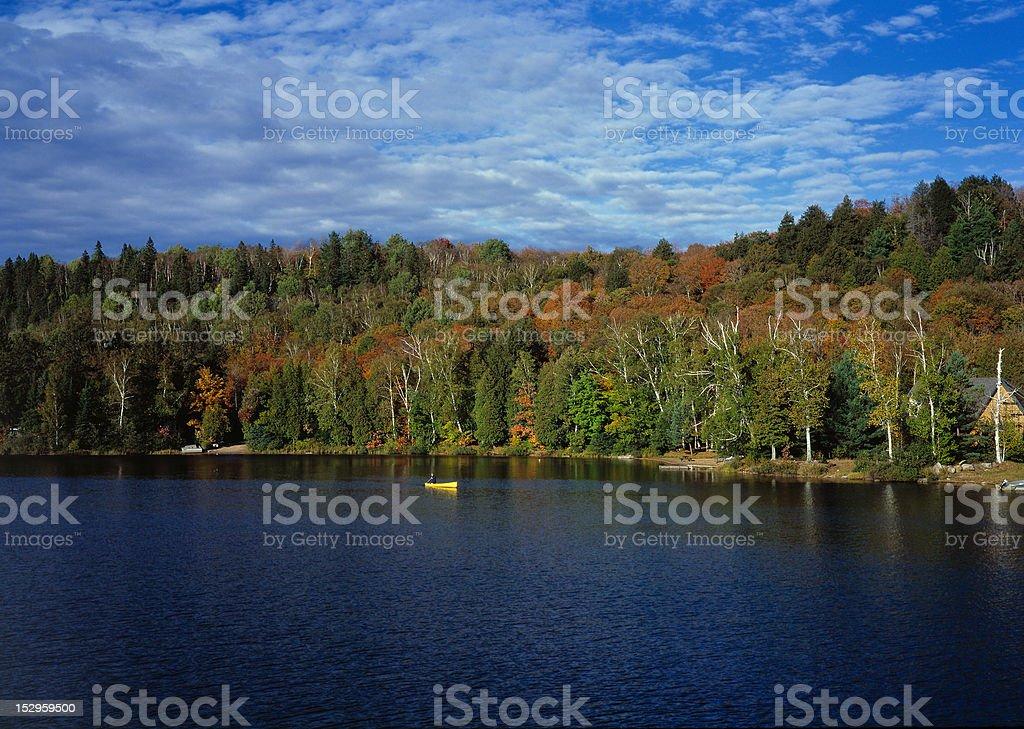 Yellow canoe on a lake royalty-free stock photo