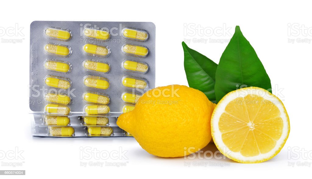 Yellow capsule pills with lemons royalty-free stock photo